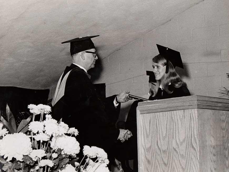 Dr. Cook awarding a diploma